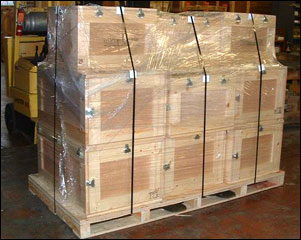 Crates with latching lids on pallet for shipping