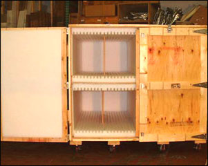 Crates for trade show with slots in foam, hinged doors for access