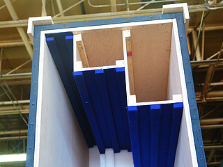 Interior crate close-up of foam with slots for paintings