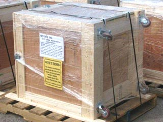 Wooden shipping crate with casters